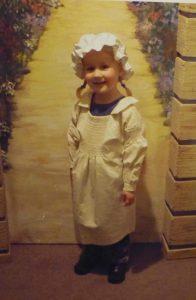 Girl in Victorian smock
